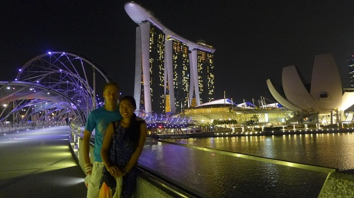 With the Marina Bay Sands Hotel at the background