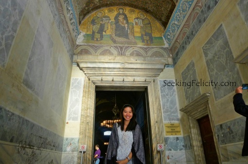 Posing in front of the Sunu Mosaic that dates back to the 10th century