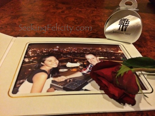 Souvenirs include a photograph, sweets, and a rose. :)